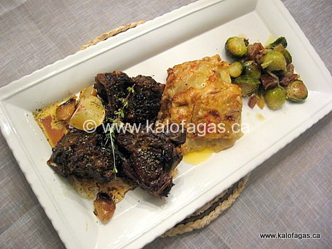 Slow-Roasted Goat With Scalloped Potatoes and Brussel Sprouts