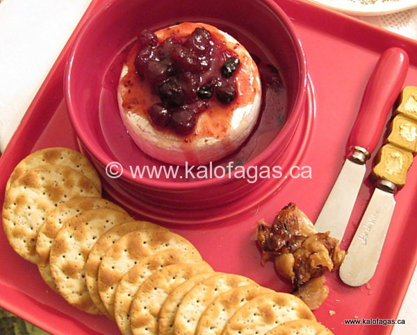 Baked Brie With Roasted Garlic & Cranberry-Mavrodaphne Sauce